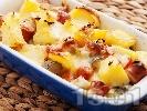 Рецепта Запечени картофи с дебърцини, краставички и кашкавал